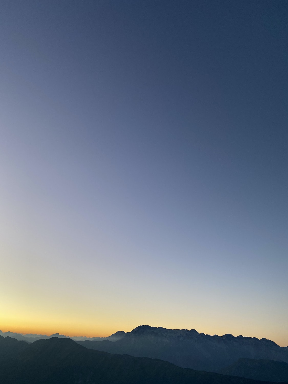 a perfect gradient on the sky during a sunrise over the mountains